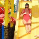 Billie Faiers in Red Swimsuit at a water park in Dubai - 454 x 512