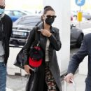 Bella Hadid – Pictured with her bodyguard while leaving her hotel and jetting off from Milan - 454 x 703