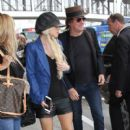 Richie Sambora and Orianthi are seen at LAX on April 9, 2016.