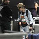 Kristen Stewart in Denim – Arrives at LAX Airport in Los Angeles