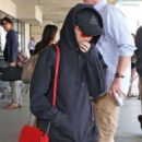 Maisie Williams at LAX Airport in LA July 12, 2017 - 454 x 570