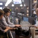 Jimmy Olsen (SAM HUNTINGTON, left) and his old friend Clark Kent (BRANDON ROUTH, center) greet Bo the bartender (JACK LARSON) at the Daily Planet reporters' usual watering hole in Warner Bros. Pictures' and Legendary Pictures' action adv - 454 x 303