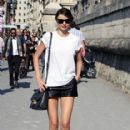 Miranda Kerr takes a stroll as she makes her way to the Dior Ready-to-Wear Spring/Summer 2012 show during Paris Fashion Week. 09/30/2011