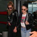 Kristen Stewart and Stella Maxwell at Charles de Gaulle airport in Paris - 454 x 706