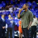 Singer and Cleveland Cavaliers part-owner Usher performs the national anthem prior to Game Four of the 2015 NBA Finals between the Golden State Warriors and the Cleveland Cavaliers at Quicken Loans Arena on June 11, 2015 in Cleveland, Ohio