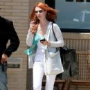 January Jones shows off her red hair as she shops at Barneys New York in Beverly Hills