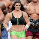 Danica Patrick displays bulky frame to film Super Bowl commercial..... but it's just a muscle suit - 454 x 574