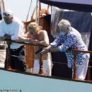 Queen's Roger Taylor uses a pole and shoots an AIRGUN at jellyfish whilst on a boat ride with his wife and children during sun-soaked holiday in Spain, 31 May 2019 - 454 x 380
