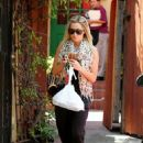 Ashley Tisdale grabbing some takeout for lunch (August 17)