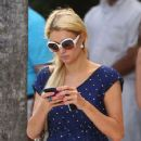 Paris Hilton relaxes near the pool at her hotel in South Beach. She looked chic in a polka dot print dress