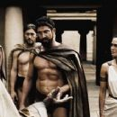 Leonidas (GERARD BUTLER, center) warns the Persian Messenger (PETER MENSAH) to choose his words wisely as Captain (VINCENT REGAN, left) and Gorgo (LENA HEADEY) look on in Warner Bros. Pictures', Legendary Pictures' and Virtual Studios' a