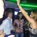 Mick Jagger shows off his dance moves as he parties with a bevy of beauties