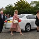 Emilia Clarke – Arriving at Kit Harington and Rose Leslie wedding in Scotland