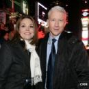 Erica Hill with Anderson Cooper in Times Square for CNN's New Year's coverage 2008 - 320 x 298