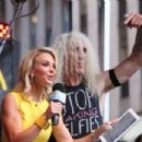 Dee Snider of Twisted Sister on stage with host Elisabeth Hasselbeck during 'FOX & Friends' All American Concert Series outside of FOX Studios on July 25, 2014 in New York City