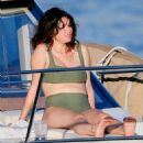 Selena Gomez – In green bikini on a luxury yacht in Hawaii