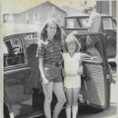 She is standing next to her own car, a Volkswagen - 370 x 472