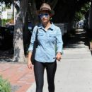 Cara Santana throws up a peace sign while out and about in West Hollywood, California on August 7, 2014