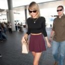 Taylor Swift guided by security through LAX