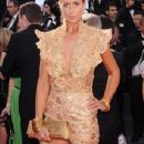How embarrassing! A bra-less Lady Victoria Hervey gets kicked off the red carpet in Cannes after posing for too long - 306 x 675