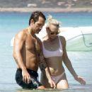 Robin Wright in Bikini at the beach in Formentera - 454 x 521