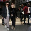 Brie LarsonandAlex Greenwald at LAX Airport in Los Angeles - 454 x 418