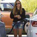 Christine Ouzounian stops to fill up her new Lexus in Newport Beach, California on August 13, 2015