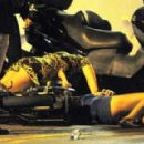 Tara Reid collapses on parked motorcycles during drunken stupor on St. Tropez vacation