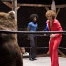 "Andy Richter (center left) as ""Bobby Dee"" and ""Clarence 'Coffee Black' Withers"", played by Andre Benjamin (center) look on as ""Jackie Moon"", played by Will Ferrell (right) prepares to wrestle Dewie the Kille"