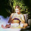 Hailey Bieber in Blue Bikini at a pool in Miami