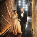 Regina King and Brad Pitt At The 92nd Annual Academy Awards - Backstage
