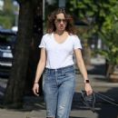 Troian Bellisario – Walking her dog in LA - 454 x 673