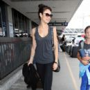 Olga Kurylenko Departing On A Flight At LAX