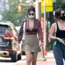 Emily Ratajkowski – In mini skirt out for a walk with a friend in New York