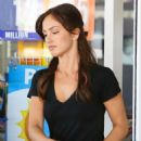 Minka Kelly: filling up her gas tank  in Beverly Hills