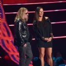 Vince Neil and Sara Evans present an award onstage at the 2014 CMT Music Awards at Bridgestone Arena on June 4, 2014 in Nashville, Tennessee