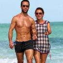 Becki Newton And Chris Diamantopoulos Out For A Stroll On The Beach