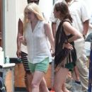 Elizabeth Olsen and Dakota Fanning on the set of