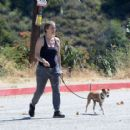 Alicia Silverstone – With her dogs while out for a hike in LA