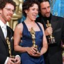 "Frances McDormand(C), Best Actress Oscar winner for her role in 'Fargo,' poses with her husband Joel Coen(R) and his brother Ethan Coen(L), who jointly won the Best Original Screenplay for ""Fargo"" (1997)"