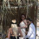 Lindsay Lohan at a beach bar in Mykonos
