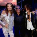 Steven Tyler, Roberto Cavalli and Joe Perry attend the Roberto Cavalli show during the Milan Menswear Fashion Week Spring Summer 2015 on June 24, 2014 in Milan, Italy - 454 x 338