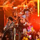 Aerosmith and Post Malone perform onstage during the 2018 MTV Video Music Awards at Radio City Music Hall on August 20, 2018 in New York City - 446 x 600