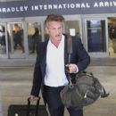 Sean Penn is spotted arriving at the Bradley International Terminal at LAX on March 25, 2017 - 400 x 600