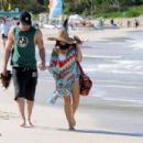 Channing Tatum and pregnant wife Jenna Dewan hold hands as they go for a romantic stroll along the beach in the French West Indie