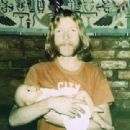 Duane Allman holding his daughter Galadrielle - 454 x 311