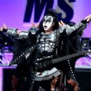 Musician Gene Simmons of KISS performs onstage during the 23rd Annual Race To Erase MS Gala at The Beverly Hilton Hotel on April 15, 2016 in Beverly Hills, California - 454 x 324