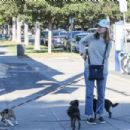 Calista Flockhart with her dogs off at a pet boutique in Brentwood - 454 x 302