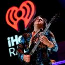 Recording artist Steve Stevens performs onstage during the first ever iHeart80s Party at The Forum on February 20, 2016 in Inglewood, California. - 399 x 600
