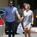 Jennie Garth and husband Dave Abrams g out shopping at Macy's in Los Angeles, California on August 26, 2016 - 454 x 572